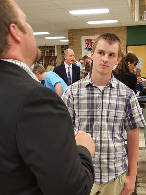 Sophomore Caleb Koppa talks with instructor Jim Dahlgren at the Young Entrepreneurs Academy graduation on Monday, June 6, 2016, at D.C. Everest Senior High School.