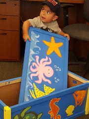 """The first child to receive a toy box made by Cornerstone Search Group associates was 1½-year-old Ethan, who chose a toy box with a sea creatures motif. Thanks to Cornerstone, Ethan also received a carton full of new toys and art supplies.""""How much more do you need to say when you see those pictures?"""" asked Steve Raz, Cornerstone Co-Founder and Managing Partner. """"Just fantastic."""""""