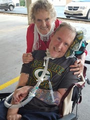 Erich Moan and his mother Margrite pose for a photo outside the Marathon County Courthouse after an Aug. 22, 2016, hearing on the future of North Central Health Care.