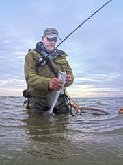 We caught keeper trout in a waist-deep tide, using soft plastics.