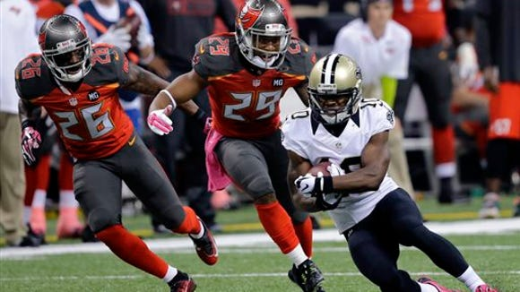 Asheville High alum Crezdon Butler (26) was released by the Tampa Bay Buccaneers last week.
