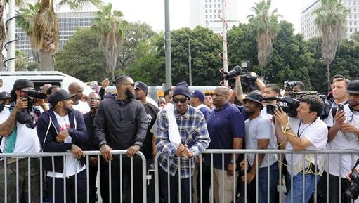 Rappers The Game (third from left) and Snoop Dogg (center) lead a march Friday in support of unification outside of the graduation ceremony for the latest class of Los Angeles Police recruits.