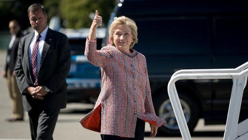Democratic presidential candidate Hillary Clinton gives a thumbs up as she arrives to board her campaign plane at Westchester County Airport Thursday, Sept. 15, 2016, to travel to Greensboro, North Carolina, for a rally.