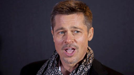 US actor Brad Pitt poses for photographers during a photocall for the premiere of the new film 'Allied' in Madrid, Spain Tuesday Nov. 22, 2016.