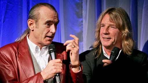 FILE - In this file photo dated Wednesday Oct. 26, 2005, showing members of Status Quo, with Francis Rossi, left, and Rick Parfitt during the launch of a DVD to mark the 40th anniversary of the rock band in London. Status Quo guitarist Rick Parfitt has died in Spain at age 68, according to a statement released by his manager Simon Porter, Saturday Dec. 24, 2016.