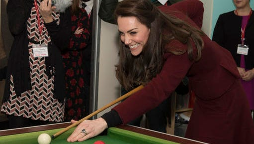Britain's Princess Kate Duchess of Cambridge has a go at playing pool during her visit to Action for Children project MIST, a child and adolescent mental health project which works specifically with children who are living in care, in Torfaen, Wales, Wednesday Feb. 22, 2017.  This is the first engagement for Princess Kate with Action for Children since becoming its Patron in December, following on from Her Majesty The Queen.