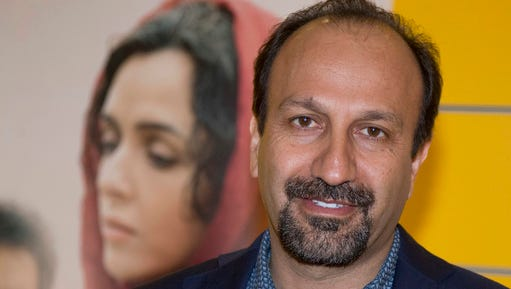 """FILE - In this Oct. 10, 2016 file photo, Iranian director Asghar Farhadi poses for a photo during the premiere of his film, """"The Salesman, in Paris.  The Oscar-nominated Iranian film director has sent a video message to a rally attended by celebrities and top talent agents to thank the Hollywood community for its support during his boycott of the awards ceremony. Last month, after U.S. President Donald Trump issued an executive order temporarily banning immigrants from seven Muslim majority countries, including Iran, Asghar Farhadi decided to boycott the Oscars."""