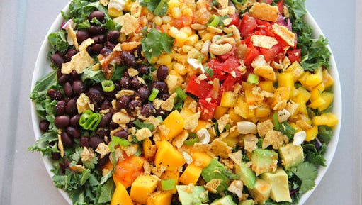 This March 9, 2017 photo shows a black bean and mango salad in Coronado, Calif. This dish is from a recipe by Melissa d'Arabian.