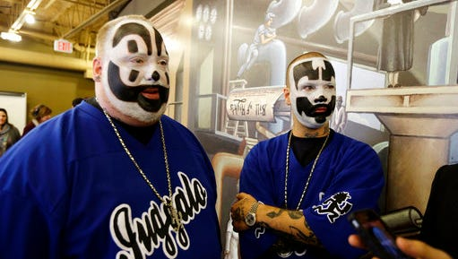 FILE - This Jan. 8, 2014, file photo shows Joseph Bruce aka Violent J, left, and Joseph Utsler aka Shaggy 2 Dope, members of the Insane Clown Posse after a news conference in Detroit. Stanley Gebhardt, of Ohio, filed a copyright infringement suit Tuesday, March 28, 2017, in federal court in Detroit saying the rap-metal group and member Joseph Bruce used a poem he wrote without his consent.