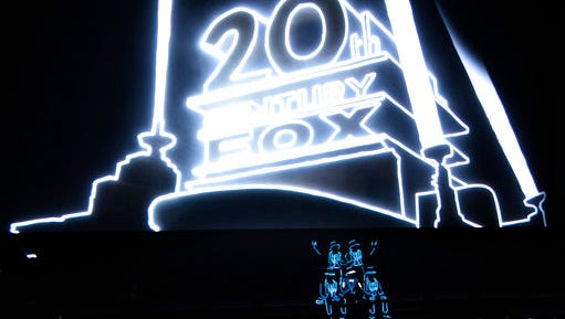 Illuminated performers pose onstage at the start of 20th Century Fox's presentation at CinemaCon 2017 at Caesars Palace on Thursday, March 30, 2017, in Las Vegas.