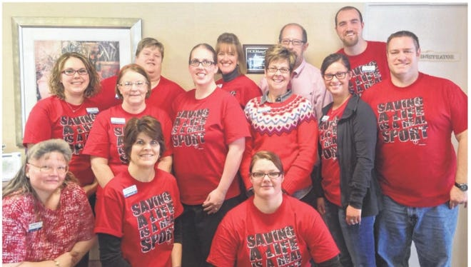 """Employees and staff members at ManorCare Health Services participated in National Wear Red Day and """"Go Red"""" for Heart Awareness Month by wearing red on Friday, Feb. 6. Staff, from front left include: Tammy Kulow, Cheryl Barfnecht and Katie Oestrich. Row two: Courtney Stolper, Susan Schrader, Miranda Seefeldt, Stacy Nies, Kayla Lukoski and Robert Lange. Back row: Ellie Finke, Barb Ritche, John Hoffmaster and Nic Riggs."""