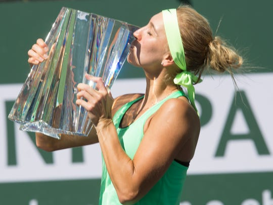 Elena Vesnina of Russia kisses her trophy after beating her compatriot Svetlana Kuznetsova in the Women's Singles championship match at the 2017 BNP Paribas Open on March 19, 2017 at Indian Wells, CA.