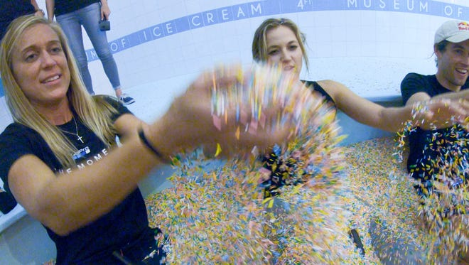Kelly Baker from GoPro throws sprinkles up at the Museum of Ice Cream in San Francisco