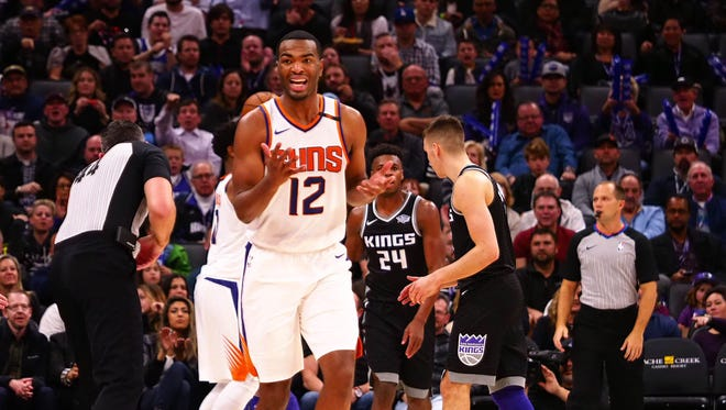 Dec 12, 2017:Phoenix Suns forward TJ Warren (12) reacts after being called for stepping out of bounds against the Sacramento Kings during the second quarter at Golden 1 Center.