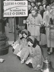The Indianapolis Fire Dept. collect dimes for the Mile