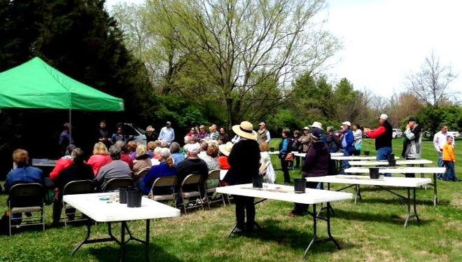 Fruit growing enthusiasts, amateurs and experts gather to learn grafting techniques.