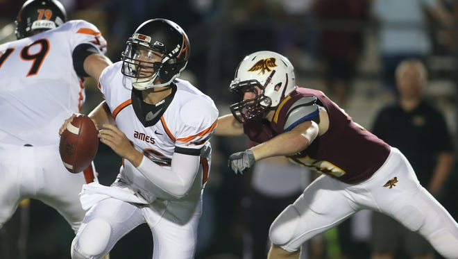 Ames quarterback Michael Frankl scrambles during a high school football game between Ames and Ankeny in 2014.