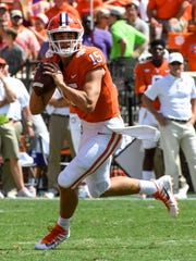 Clemson quarterback Hunter Johnson (15) passes against Kent State during the fourth quarter in Memorial Stadium at Clemson on Saturday.