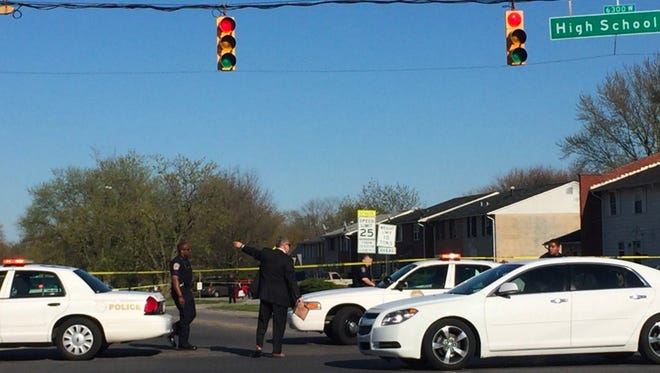 IMPD officers investigated the scene of a fatal shooting Friday, April 15, 2016, at Gateway Drive and High School Road on Indianapolis' west side.