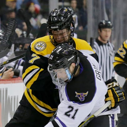 Michigan Tech forward Blake Pietila (19) scores on Minnesota State goalie Stephon Williams during last week's WCHA title game. Pietila, a Brighton native, and his Tech teammates take on St. Cloud State today in the first round of the NCAA tournament.