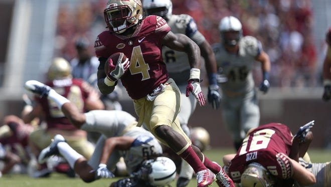FSU's Dalvin Cook takes off for a 37-yard TD run against Charleston Southern during their game at Doak Campbell Stadium on Saturday, September 10, 2016.