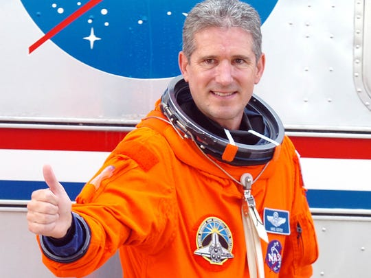 Astronaut Mike Good seen in 2010 before launching on STS-132.