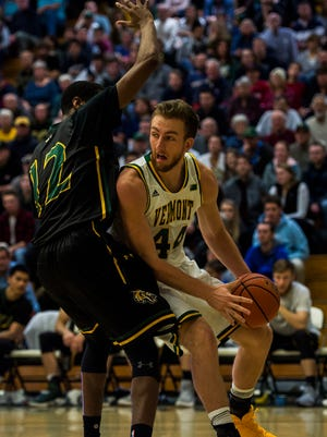 UVM's Nate Rohrer looks for the open man during their men's basketball match up against UMFK at Patrick Gym on Wednesday night, Nov. 22, 2017.