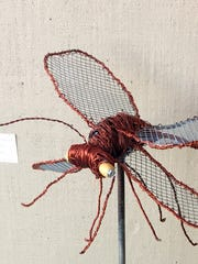 "Warren Gray submitted his ""Dragonfly with Bug"" art work for the 2017 Recycled Art Art Show."
