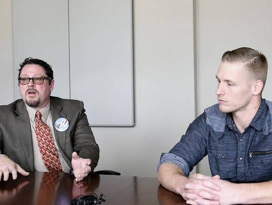 Aaron Aylward (right), chair of the South Dakota libertarian