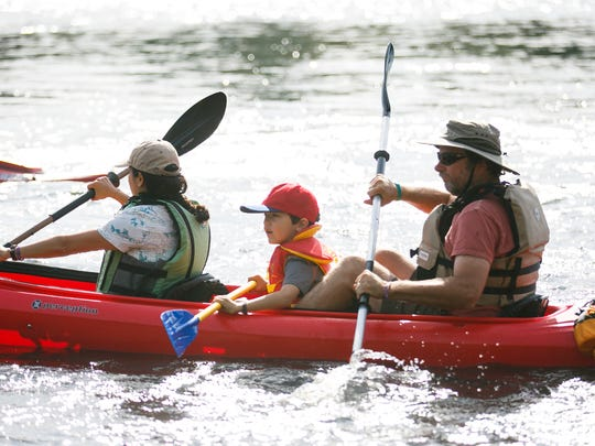 Kayakers take off from Riverview Park in Independence as the Great Willamette River Raft Race gets underway on Saturday, Aug. 13, 2016.