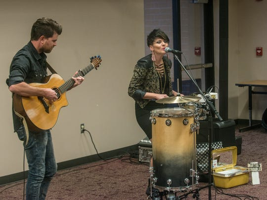 Martha's Trouble performs during an open house/job fair at the Montgomery Advertiser.