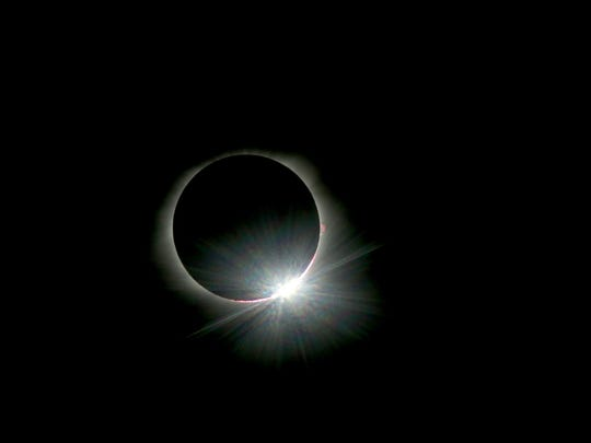 The diamond ring appears as the moon starts to move away from totality during the total eclipse on Monday, Aug. 21, 2017.