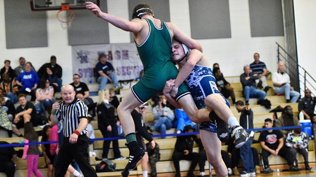 Chambersburg's Cole Grove, momentarily on his head,