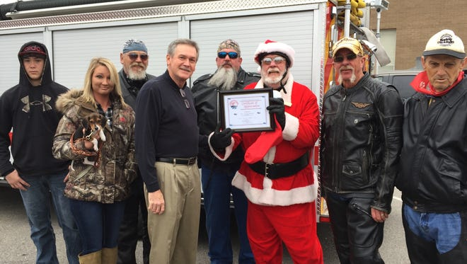 Stewart County Mayor Rick Joiner, center left, presents SCCB members with a certificate of appreciation for orgainizing the toy run.