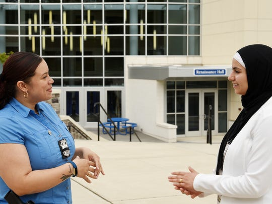 Huda Shalabi, right, a Berkeley College student, works toward a career in law enforcement while helping her large family in Paterson. She interned with the Paterson Police Department this spring. At left is Paterson Police Officer Irsi Velez, Shalabi's supervisor when she interned at the department. The two have remained close.