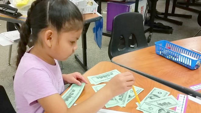 One student was excited and asked if the hundred dollar bills were real.