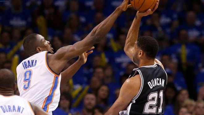 Oklahoma City forward Serge Ibaka (9) blocks a shot by San Antonio forward Tim Duncan during the first quarter of Game 4 of the Western Conference finals on Tuesday night. The game was too late for this edition.