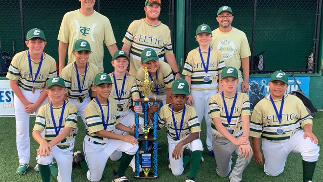 The Trinity Catholic Celtics 11U baseball team poses with its trophy after placing second at the Gainesville Invitational in early June.