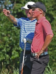 Brent Hofman tutors his caddy, Harrison golfer Nic Hofman, during the Men's City Golf championship Sunday morning.