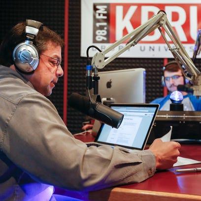 Jonathan Groves, station advisor for KDRU Radio, records