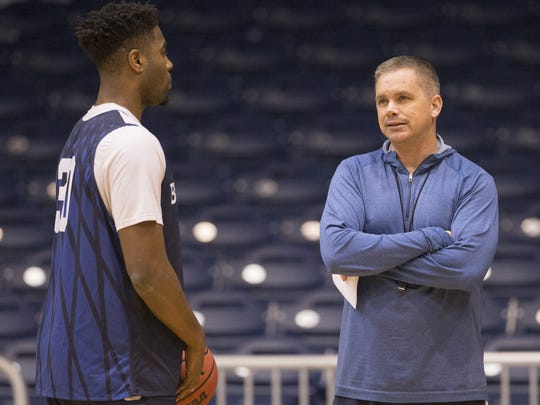 "Senior Kelan Martin, left, said of his former coach, Chris Holtmann:  ""We're just being positive about the situation and trying to get over it. You can't beat the situation he had at Ohio State, the offer he had."""