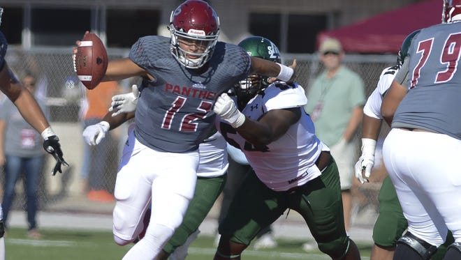 Florida Tech QB Mark Cato avoids the tackle of Delta State's Jaterrian Wren during Saturday's game.