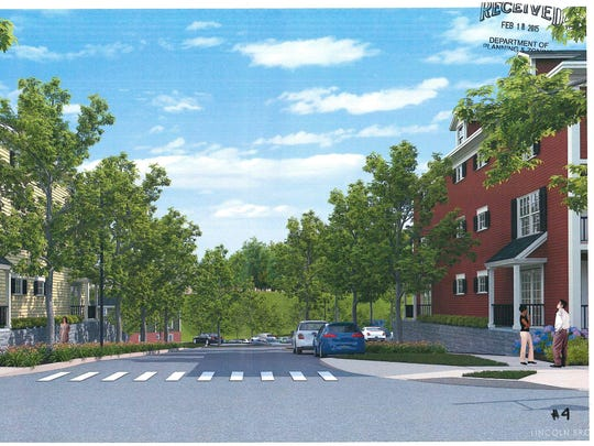 A rendering of apartment buildings in a new 232-unit housing development proposed behind Grove Street in Burlington.
