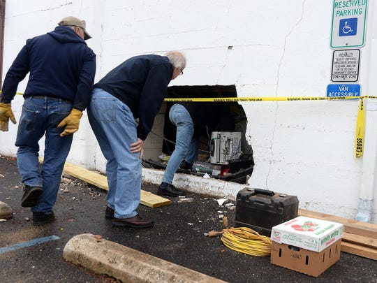 Comuter equipment and a car's bumper cover can bee seen inside the hole left in the wall of Main Street Market in Millville after a car drove into the building Sunday morning, Nov, 29.