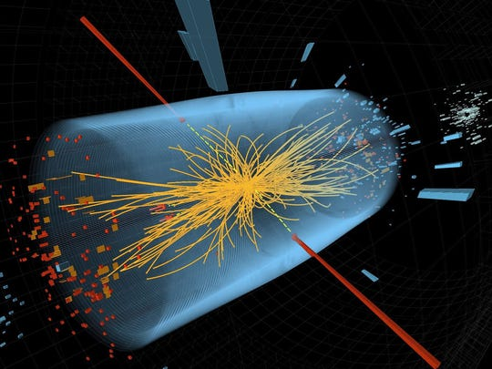 Two high-energy photons whose energy, depicted by red towers, is measured in a collision at the Large Hadron Collider. The yellow lines are the measured tracks of other particles produced in the collision.