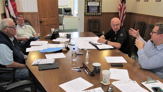 Deputy Director Luke Hall (right) and Holmes County Emergency Management Agency Director Gary Mellor made a presentation to Holmes County Commissioners Joe Miller and Rob Ault on Monday.