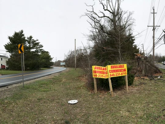Stores and upper story apartments are proposed on a parcel of land between Route 88, Jack Martin Boulevard and Burrsville Road.