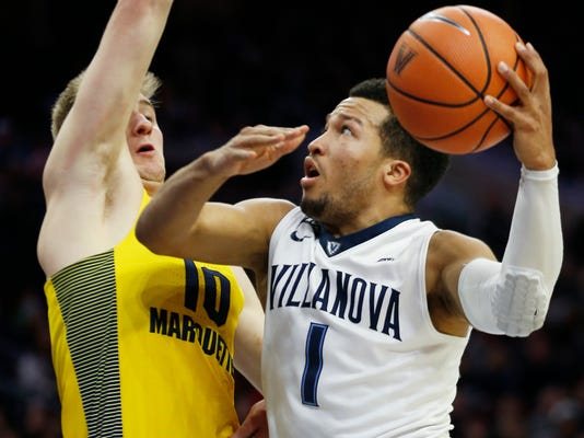 Villanova guard Jalen Brunson (1) goes to the basket as Marquette guard Sam Hauser (10) defends during the second half of an NCAA college basketball game Saturday, Jan. 6, 2018, in Philadelphia. Villanova won 100-90. (AP Photo/Laurence Kesterson)