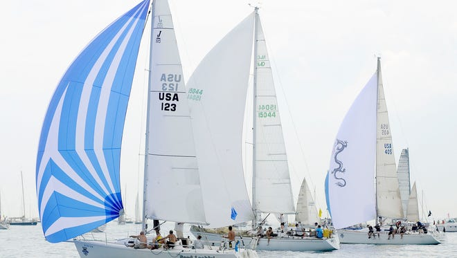Good Lookin', of the Port Huron Yacht Club,Velero VII, of Bayview Yacht Club, and White Water Dragon, of Bayview Yacht Club, race up the lake Saturday, July 18, 2015 during the start of the Port Huron-to-Mackinac Island Sailboat Race.