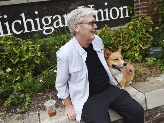 Michael P. Sola sits with his corgi, Reggie, in Ann
